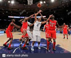 St. John's Red Storm forward Chris Obekpa, Villanova Wildcats guard Darrun  Hilliard (4) and Red Storm guard Sir'Dominic Pointer (15) try for the  rebound during the first half of their NCAA men's