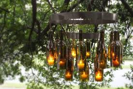 transform your outdoor living space with this diy glass bottle chandelier