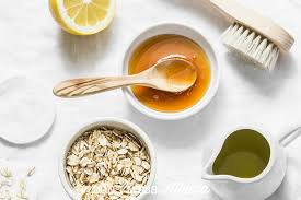 closeup of honey lemon oats olive oil and brush to make diy beauty