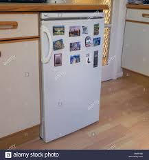 Kitchen Setting Refrigerator With Fridge Magnets Attached In A Domestic Kitchen