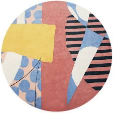 round colorful rug with irregular shapes blue and white yellow black