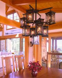 post and beam dining table with craftsman style lighting