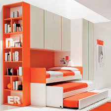 kids bedroom furniture kids bedroom furniture. Orange Accent Triple Trundle Bunk Bed With Bookcase Storage And White Wardrobe For Kids Bedroom Furniture