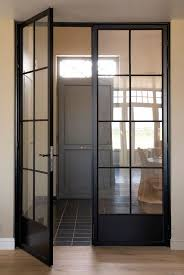 Steel doors with oak flooring and furniture can make a great on-trend  hallway -
