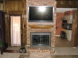 kitchen room design fireplace tv above over wooden