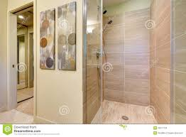 Tile For Bathroom Shower Walls Bathroom Shower With Glass Doors And Natural Color Tiles Stock