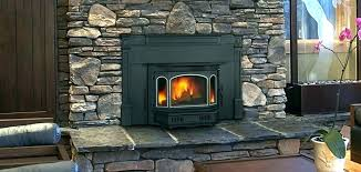 wood burning fireplace with gas starter stove