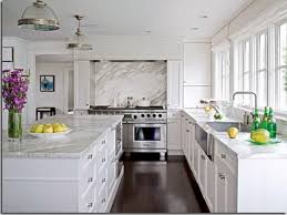white innermost cabinets with cozy quartzite countertops and dark pergo flooring for enchanting kitchen design