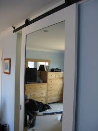 mirrored barn door for master closet