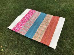 on one end of the quilt leave a 10 opening once the layers have been sewn together clip each corner of the quit