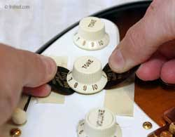 replacing guitar pots switches wiring and shielding removing press on knobs guitar picks for leverage