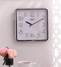 white plastic square shape wall clock