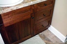 solid walnut vanity with custom travertine countertop
