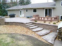 raised paver patio with retaining walls stairs deck and seating wall