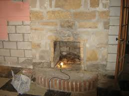 soot stains over a fireplace can ruin a focal point in a room and detract from the beauty of the stone tile or brick facing