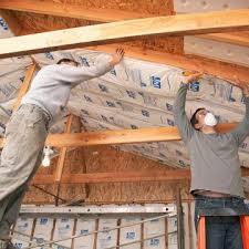 garage ceiling insulation.  Insulation 2 Men Putting Insulation In Ceiling In Garage Ceiling Insulation O