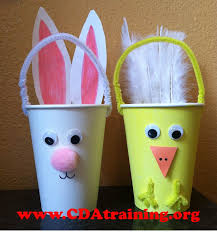 we used paper cups and accessorized them with pompoms paper feathers wiggly eyes and pipe cleaners we also painted the white cup yellow for our