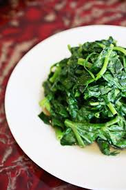the stir fried pea sprouts with garlic are one of several vegetable sides on the