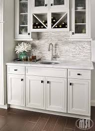 to incorporate the trending gray colors for 2016 a white quarry splitface tile backsplash complements the soothing tonal visuals of light gray cabinetry