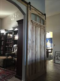 interior sliding barn door made of hickory and textured glass arched glass detail arts
