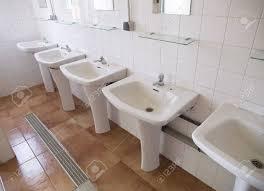 public bathroom sink. Public Bathroom With Multiple Sinks Placed In Row Stock Photo - 15092870 Public Sink