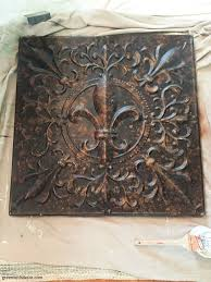 bronze metal piece before it s painted for a diy wall art project