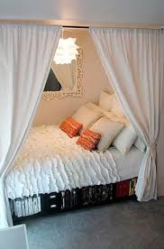 Small room turn bed sideways create a more personal spot add curtains :)