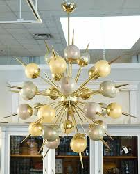striking murano glass and brass sputnik style chandelier with an array of 30 globes in gold