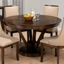 expandable round pedestal dining table. rich walnut wood round pedestal dining table expandable