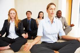 meditation in office. portrait of multi racial business group meditating together at office meditation in p