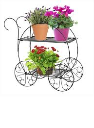 use this decorative cart finished in a deep hunter green to nicely display your potted plants flowers the cobraco 2 tiered garden cart is perfectly