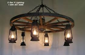 WW026-60-8 - 60-inch diameter single-tier rustic wagon wheel chandelier  light fixture - with eight hanging lantern lights. Shown with painted rust  finish.