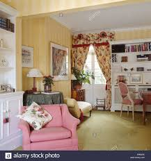 Patterned Curtains Living Room Striped Yellow Wallpaper And Pink Armchair In Living Room With