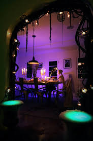 spooky lighting. Scary Halloween Dining Room Decor With Spooky Lighting And Skeleton Prop