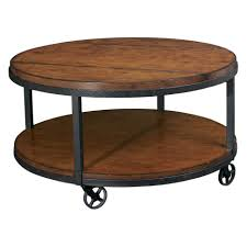 round brown wooden coffee table with shelf also black