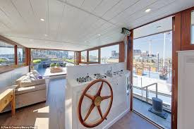 the wheelhouse of the luxury barge that is moored in south west london and has gone
