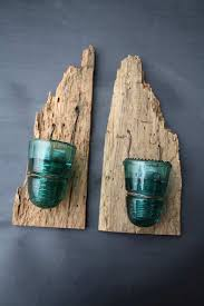 vintage glass insulators and wormy wood becomes a beautiful rustic set of candle holders