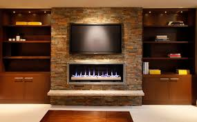 toronto electric fireplace ideas with contemporary fireplaces basement transitional and built in cabinets stone wall