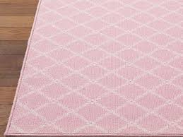 image of unique light pink rug for nursery