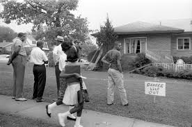 this is an essay about the ncaap and its fight against segregation group of african americans viewing the bomb damaged home of arthur shores naacp attorney