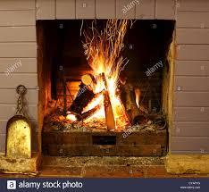 open fireplace burning wood