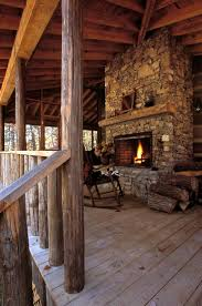 log cabin porch with stone fireplace
