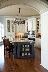 diy kitchen island with cabinets. kitchen island ideas diy with chandelier and wood flooring also glass door cabinets open shelving pale blue walls plus leather counter stools
