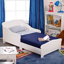 navy blue loose curtained window near white mini bed and also navy blue kids rug ideas for toddler boy room