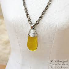 learn a simple technique to create a wire wrapped pendant using dollar stones
