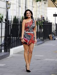 The stylish dress had a square neckline and puffed out at the sleeves. Kelly Brook One Shoulder Dress Kelly Brook Looks Stylebistro