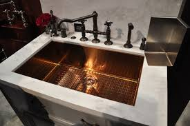 rohl sink 16 gauge copper infused snless steel model it is very solid and has a sound deadening material applied to the outside