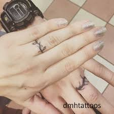 30 Best Ring Finger Tattoo Ideas For A Couple You Must Try Dmh Tattoos