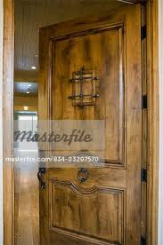 open front door. Detail Open Front Door With Speakeasy Window - Stock Photo
