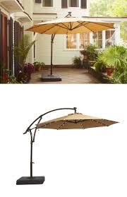 white striped patio umbrella: theres something special about this patio umbrella it has small solar powered led lights